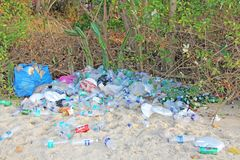 India, Goa, February 05, 2018. Empty plastic and glass bottles lie on the beach and pollute the ecology of the sea.  stock photography