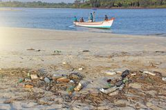 India, Goa, February 05, 2018. Empty plastic and glass bottles lie on the beach and pollute the ecology of the sea.  stock images