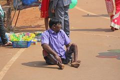 India, GOA, January 28, 2018. A disabled man is sitting on the street in India and asks for money.  stock image