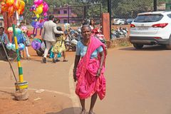 India, GOA, January 28, 2018. Indian elderly woman or grandmother in pink and blue saris, in India royalty free stock photos
