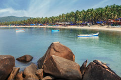 India, Goa, Palolem beach. Beautiful Goa province beach in India with fishing boats and stones in the sea Stock Photography