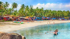 India, Goa, Palolem beach. Beautiful Goa province beach in India with fishing boats and stones in the sea royalty free stock photography