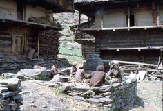 1977. India. A group of people working and relaxing. Malana. The photo shows, a small group of people working and relaxing between their houses Royalty Free Stock Photos