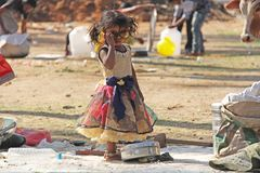 Free India, Hampi, 02 February 2018. A Small Poor And Dirty Indian Girl Playing With Sunglasses. A Little Girl In Big Glasses From The Royalty Free Stock Images - 141545609