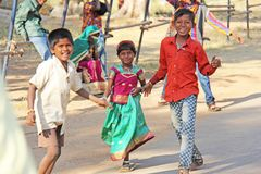 India, Hampi, 02 February 2018. Children of India, in Hampi. A group of Indian children in bright clothes and barefoot, stand and royalty free stock photos
