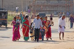 India, Hampi, 02 February 2018. The main street of Hampi village is women in bright and colorful saris, men, children, a group of royalty free stock photos