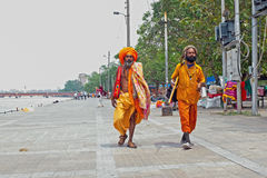 INDIA, HARIDWAR - APRIL 24, 2017: Two sadhus walking along the r Stock Photography