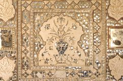 India, Jaipur: fresco on a wall. Sandy colors and geometrical designs for this wall decoration Royalty Free Stock Images