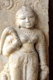 India Jaipur sculpture in an hindu temple. Representation of a woman; maybe a deva; round face and voluptuous shapes Royalty Free Stock Images