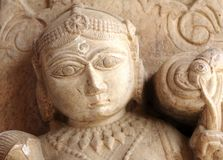 India Jaipur sculpture in an hindu temple. Representation of a woman; maybe a deva; round face and voluptuous shapes Stock Photography