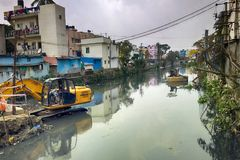 Cleaning and deepening of old city canal. India, kanniyakumari - January 26, 2016: Cleaning and deepening of old city canal, water stagnation, picture of Stock Photo