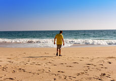 India. Kerala. The teenager on a beach. India. Kerala.  teenager on a beach Royalty Free Stock Photo