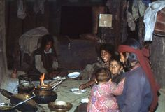 1977. India. In the kitchen. Rice and vegetables for dinner. Malana. The photo shows, a woman with some of her children, having their evening meal, rice Stock Images