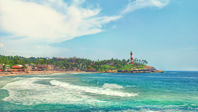 India, Kovalam beach, Kerala. Kerala province beach in India with a vivid lighthouse in the ocean. Creative filter affect royalty free stock photo