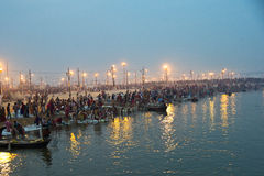 India Kumbh Mela- World's Largest Human Gathering. Pilgrims arriving to take a holy bath in the Ganges River in Allahabad for Kumbh Mela Festival Royalty Free Stock Photo