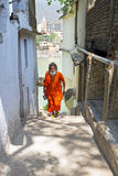 INDIA, LAXMAN JHULA - APRIL 15, 2017: Sadhu coming from the rive Stock Images