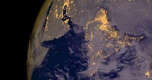 India lights during night as it looks like from space. Elements of this image are furnished by NASA. India and Middle East lights during night as it looks like Stock Photos