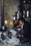 1977. India. Himalaya. A local is smoking hookah in a rest house. Stock Image