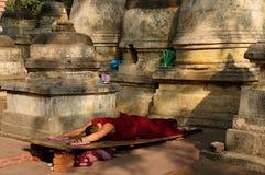 India - Mahabodhy Temple. Buddhistic monk prayer. Mahabodhy Temple in Bodhgaya, Bihar, India Royalty Free Stock Photo