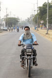India man riding a motorcycle Royalty Free Stock Photography