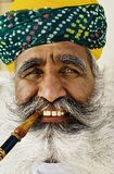 India man smoking a pipe.  Royalty Free Stock Photography