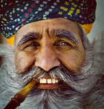 India Man Smoking Pipe Solitude Tranquil Wisdom Concept Stock Images