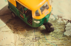 India map with the capital in Delhi and driving toy model of auto-rickshaw vehicle. Royalty Free Stock Image