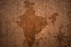India map on vintage paper background. India map on a old vintage crack paper background stock images