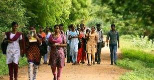 Group of college students walking together. INDIA - MARCH 28th, 2016: Group of college students walking together stock photo