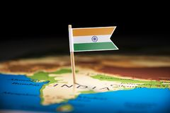 India marked with a flag on the map.  stock photo