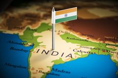 India marked with a flag on the map.  stock photos