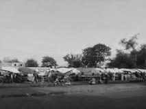 India market road side stall. India market road side umbrella vegetable public street rickshaw Stock Images