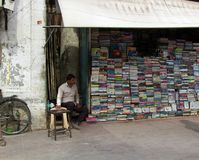 Bookseller in his street shop. India, new Delhi - March 1, 2018: bookseller in his street shop royalty free stock photography