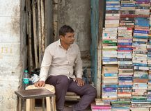 Bookseller in his street shop. India, new Delhi - March 1, 2018: bookseller in his street shop royalty free stock photo