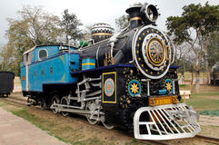 India : Old train; one of the oldest locomotives. India : one of the oldest running locomotive in the world; this is a steam powered machine; a railway machine stock photo