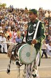 India Pakistan border ceremony. Man with a drum royalty free stock photos