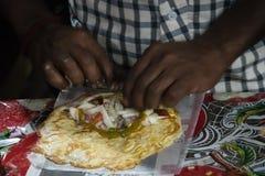 India pancake Roti cooking stock photography