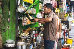In India, people take their meals on the street Stock Image