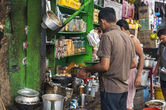 In India, people take their meals on the street Royalty Free Stock Photo
