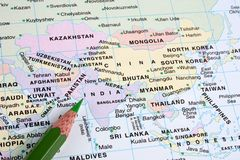 India pointed in world map. India pointed in color world map with a green pencil stock images