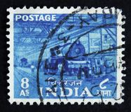 India postage stamp shows Electric train factory, circa 1930 Royalty Free Stock Image