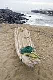 India, Puducherry, handmade crude boat on sand Royalty Free Stock Photo