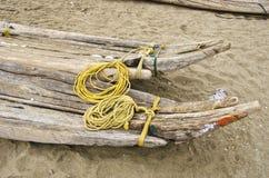 India, Puducherry, wooden handmade crude boats on sand Stock Photos