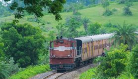Indian Rail Green Background. India Rail or Train passing through greenery and Forest on meter gauge railway track at Patalpani , Mhow, Madhya Pradesh near royalty free stock image