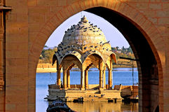 India, Rajasthan, Jaisalmer: the lake. Near Jaisalmer; blue water and golden stone architecture Royalty Free Stock Photos