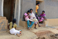 India's Tribal Lifestyle. A tribal family in a remote village of West Bengal stock photos