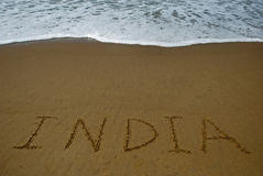 India on sandy beach Stock Images