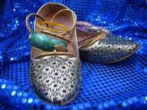India Shoes and Bangles on Blue Sequins Stock Images