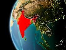 India from space in evening. Evening over India as seen from space on planet Earth with visible border lines and city lights. 3D illustration. Elements of this Stock Photo