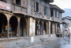 1977. India. Street scene from the town of Kullu. The photo shows, a typical street scene from Kullu, with the downstairs shops and the upstairs living space Royalty Free Stock Image